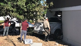 Truck crashes into apartment, 3 injured - Video