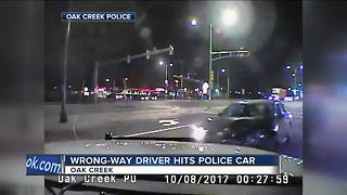 Wrong way driver slams into Oak Creek police car - Video