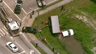 Two-vehicle crash leaves one in the water - Video
