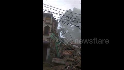 Video shows moment house crumbles to ground in India village after heavy downpour
