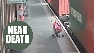 Chilling footage shows moment unattended child's buggy rolls into the path of a freight train