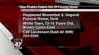 Police looking for person seen wheeling casket from funeral home - Video