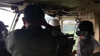 Police helicopter search for youth football team trapped in Thai cave - Video