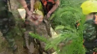 Man stuck in mud rescued by firefighters in China - Video