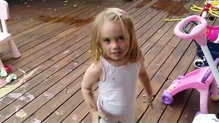 Little Girls Create Colorful Mess on the Patio - Video