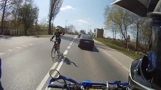 Biker randomly surprises passing cyclist with high-five - Video