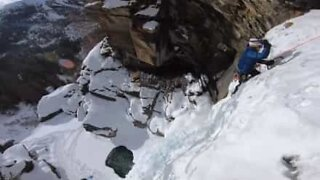 Man climbs frozen waterfall