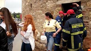 Firefighters rescue students trapped in White Tower as floods hit Greece - Video
