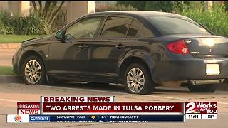 Two men arrested after car matches description of armed robbery