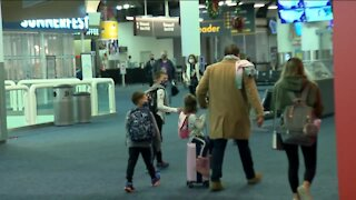 Holiday travel is down, but people are still flying out of Mitchell airport