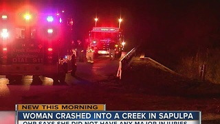 Woman safe after crashing car into a Sapulpa creek - Video