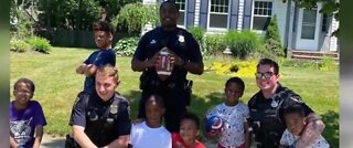 Cops join kids playing football