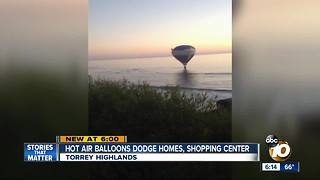 Hot air balloons dodge homes, shopping center - Video