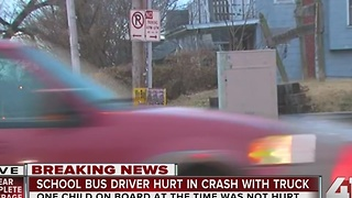 School bus driver hurt in crash with truck - Video