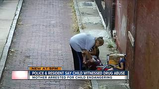 PD: Woman used drugs in alley with child present - Video