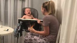 Baby can't stop laughing at mom's fake sneezes
