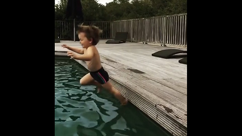 Little kid falls into pool in epic slow motion