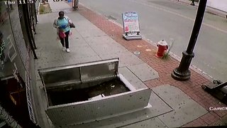 Woman Distracted by Phone Falls Into Open Sidewalk Hatch