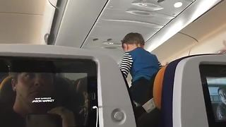 Disgruntled Passenger Films Child's Antics During 8-Hour Flight - Video