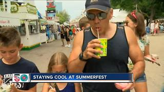 Summerfest goers trying to beat the heat - Video
