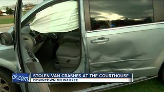 Stolen van crashes into 2 cars in front of Milwaukee County Courthouse - Video