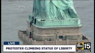 Protester climbs Statue of Liberty
