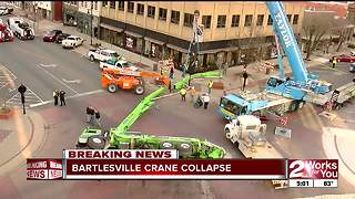 Crane tips over in downtown Bartlesville - Video