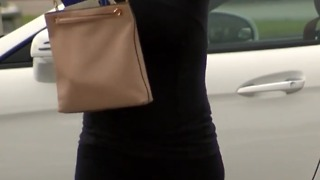 Woman says across the body purse saved her life - Video