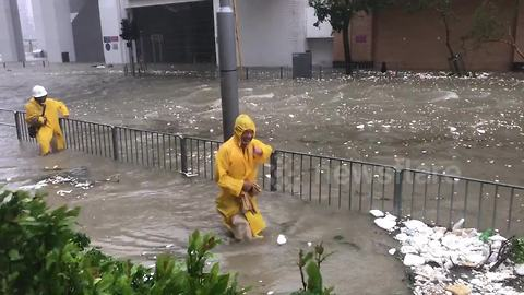 Residents tread through flooded streets as Typhoon Mangkhut brings torrential rains to Hong Kong