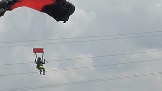 Video captures bright flash and loud crack as military parachutist crashes into high voltage power lines - Video