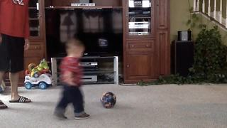 Cute Toddler Boy Crashes Into A TV While Playing Soccer - Video