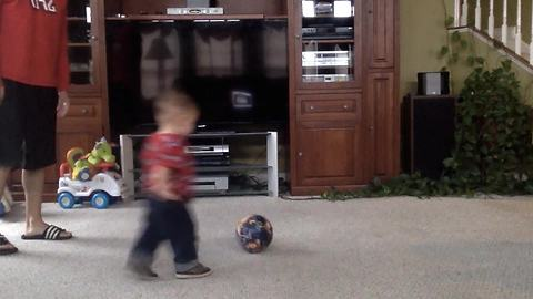 Cute Toddler Boy Crashes Into A TV While Playing Soccer