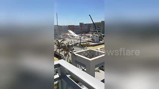 Eyewitness films pedestrian bridge seconds after it had collapsed - Video