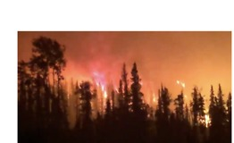 Forest Worker Drives Through Lake Shovel Fire in British Columbia - Video