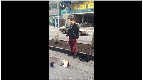 Unexpected street singer leaves pedestrians in awe!
