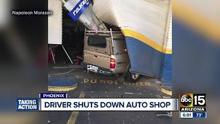 Truck smashes into Valley auto shop - Video