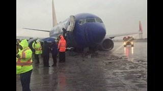 Plane Skids Down Runway at Burbank Airport Amid Rainy Weather - Video