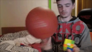 Genius Solves Rubik's Cube While Spinning Basketball - Video