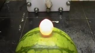 Red hot nickel ball vs watermelon - Video