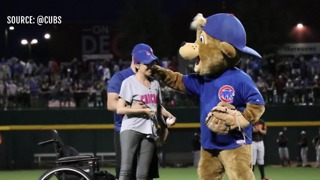 1 October shooting survivor throws first pitch at Chicago Cubs game - Video