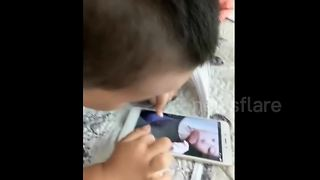 Toddler tries to breastfeed from mum over FaceTime