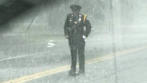 Officer Stands In Pouring Rain To Help Protect Little Snapping Turtle