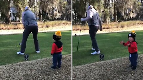This golfer has the cutest supporter ever
