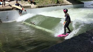 Daredevil ducks join surfers in hanging ten on river rapids - Video