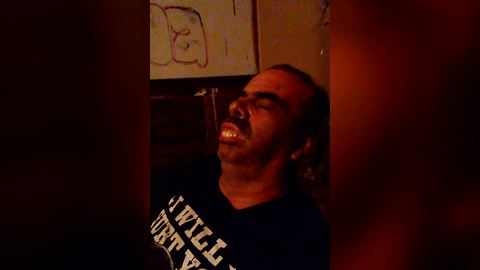 Man Snores And His Dentures Slowly Come Out Of His Mouth