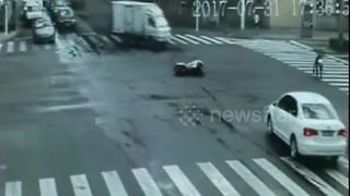 Motorcyclist crashes and slides 20 metres on road - Video