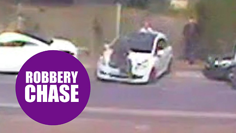 Have-a-go-hero desperately clinging to the bonnet of a getaway car