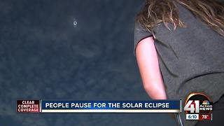 People pause for total solar eclipse
