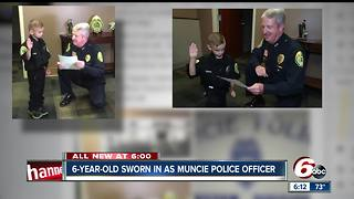 6-year-old Muncie boy becomes honorary police officer, practices writing traffic tickets - Video