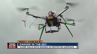 Drones flying dangerously close to airplanes over protected airspace - Video